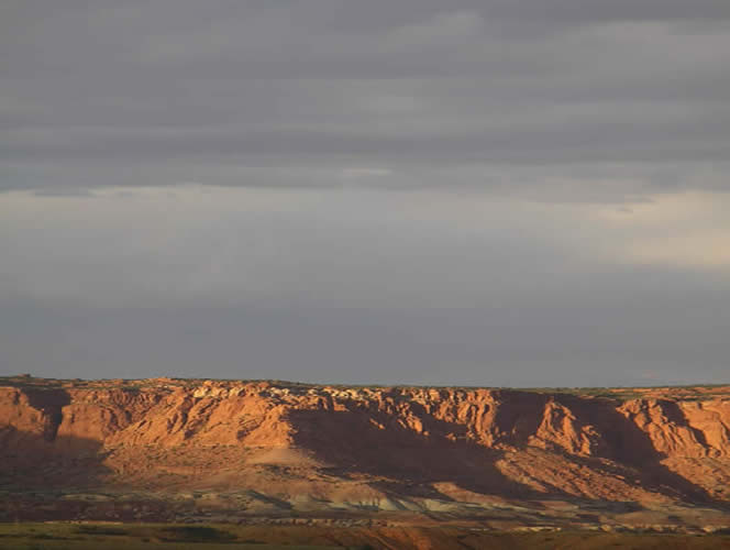 Views of the striking Moenkopi and Windgate formations are seen from the schoolhouse.